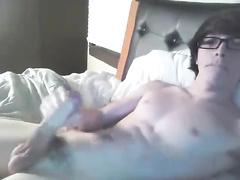 Four-eyed twink is masturbating his big dick