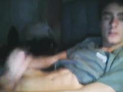 Brunette kid is jerking off by the webcam