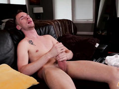 Naughty dude masturbates on the leather sofa