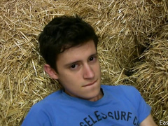 Innocent looking teen twink is undressing and wanking off on hayloft