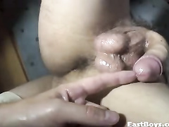 Naughty twink poses in front of the camera with pulled out cock
