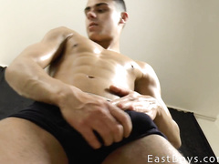 Exciting cute brunette twink hotly poses and undresses to the camera