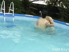 Beauty gay friends are teasing in the pool and masturbating on the bed