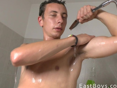 Tender tight gay is fondling his big dick in bathroom