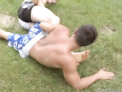 Sexy strong wrestlers are training outdoors