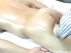 Wonderful young twink is pleasuring exciting gay massage