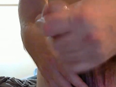 Some gay with pretty young body is recording closeup masturbation video