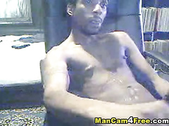 Black gay dude is pleasantly masturbating on hot gay porn