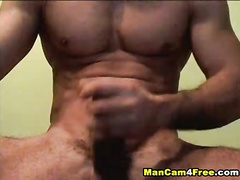 Rocky muscled twink is jerking off dick and cumming on his chest