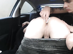 Twink gets fucked hard in the asshole in the car in doggy pose